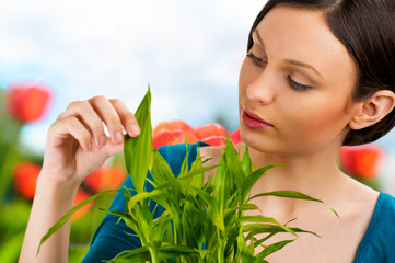 Florist woman working with flowers and plants at garden