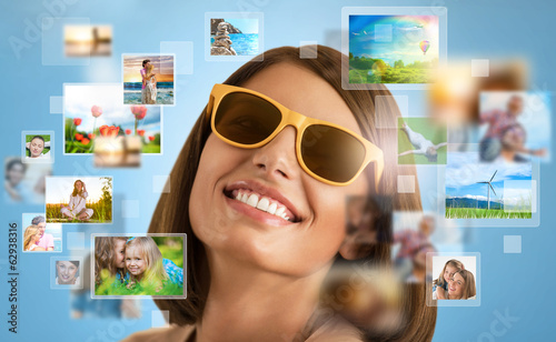 Portrait of young happy woman sharing her travel vacation photo