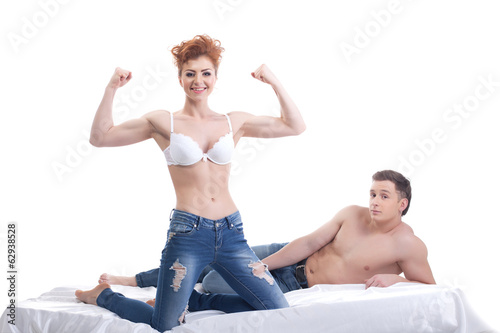 Cheerful seminude lovers posing at camera