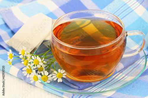 Tea with fresh chamomile flowers