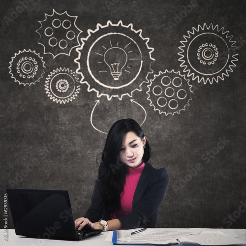 Business woman typing at laptop