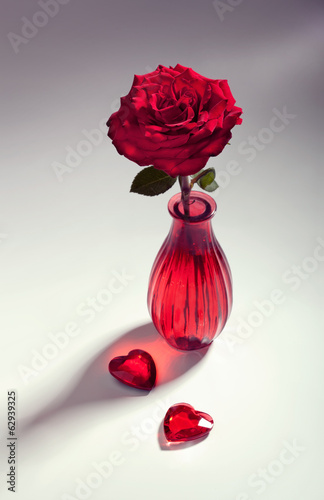 Red rose with two hearts, toned image