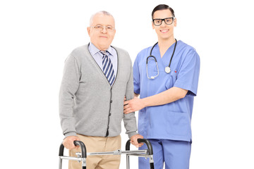 Senior gentleman with walker posing next to a male nurse