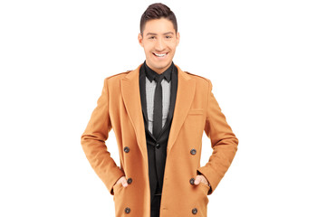 Smiling handsome man wearing coat