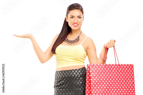 Beautiful woman holding shopping bags and gesturing