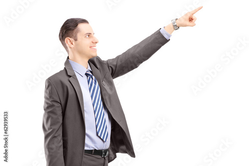 Businessman with briefcase pointing in a direction
