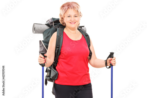 Female hiker with complete hiking equipment