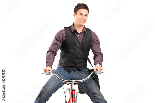 Young happy man riding a bike