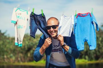 Father hiding between son's clothes