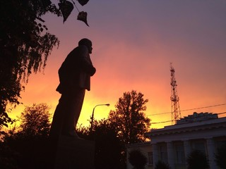 Lenin statue with dramatic red sky
