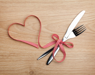 Valentine's Day heart shaped red ribbon and silverware
