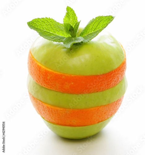 slices green apple and orange on a white background