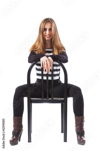 Woman sitting and holding hands on the back of the chair