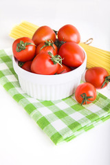 ingredients: сherry tomatoes in a bowl and  spaghetti on green