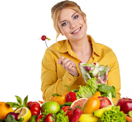 Happy young woman with vegetables and fruits. Isolated over whit