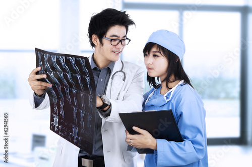 Doctors with patient xray film