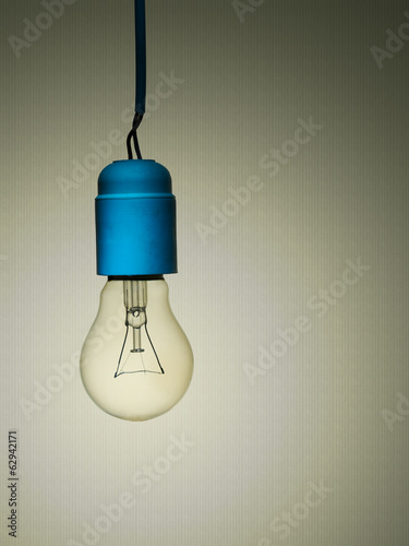 Old incandescent light bulb with bad wiring, sightly grunge