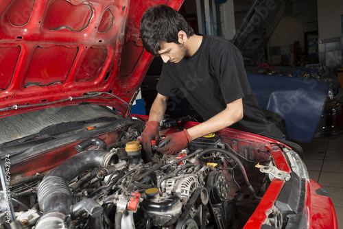 Mechanic working on old car