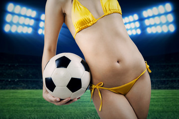 Sexy body and soccer ball