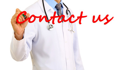 Doctor writing Contact us on transparent board