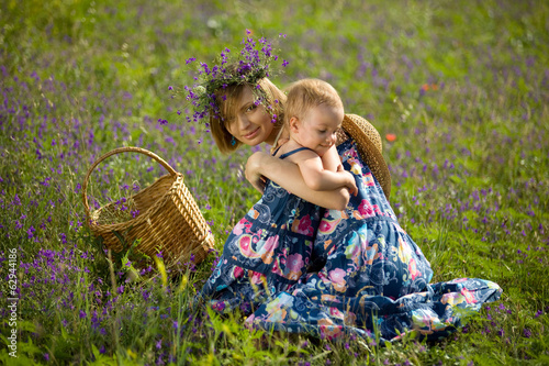 Happy mother playing with daughter in field