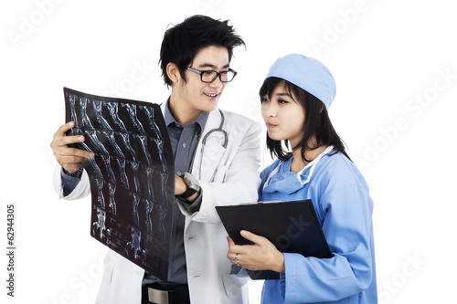 Two doctors are checking xray