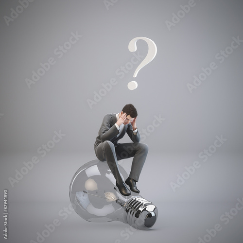 Businessman man sitting on the light bulb. Concept idea