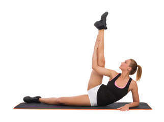 Female Stretching On Exercise Mat Before Workout