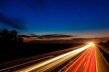 Cars speeding on a highway
