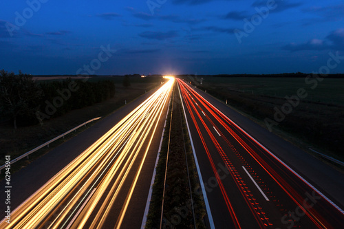 Cars speeding on a highway
