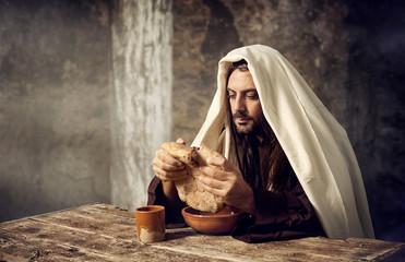 Jesus breaks the bread