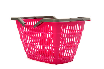 Pink plastic shopping basket.Closeup on empty market basket.