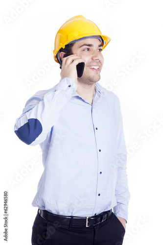 Handsome engineer talking with a smartphone, isolated on white