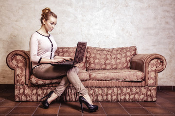 Businesswoman using computer internet at home. vintage.
