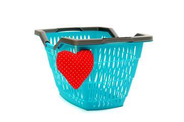 I love shopping concept. Empty market basket with a red heart.
