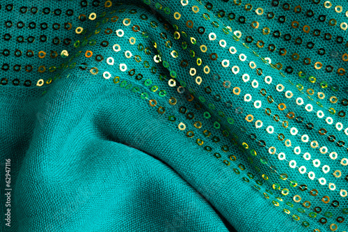 Green sequine background texture cloth wavy folds textile