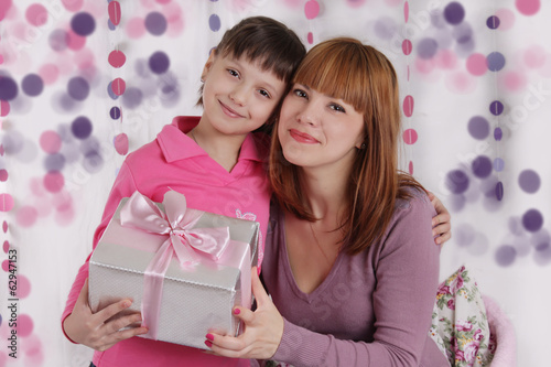 Loving mother and daughter with present