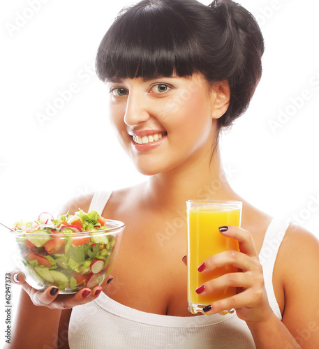 woman has breakfast salad from vegetables