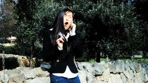 Angry chinese woman on the phone discussing