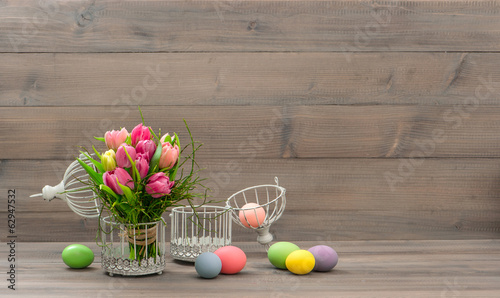 tulip flowers and colorful easter eggs