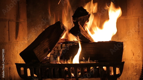 Burning wood in stone fireplace