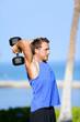Fitness man lifting dumbbells training triceps