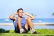 Man exercising sit-ups outside