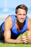 Fitness man training plank core exercise