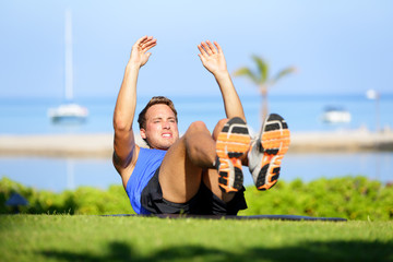 Fitness man doing sit-ups exercise for abs