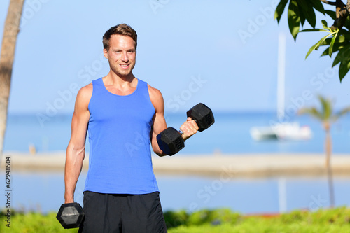 Fitness bicep curl - weight training man outdoors