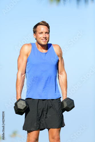 Shoulder shrug weight training fitness man outdoor