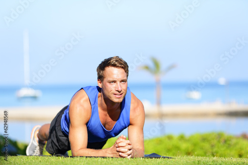 Plank core exercise - fitness man training