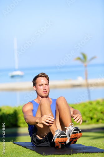 Training fitness man doing sit-ups exercise
