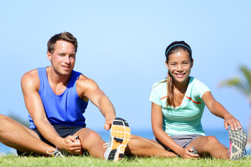 Stretching exercises - Fitness couple outside